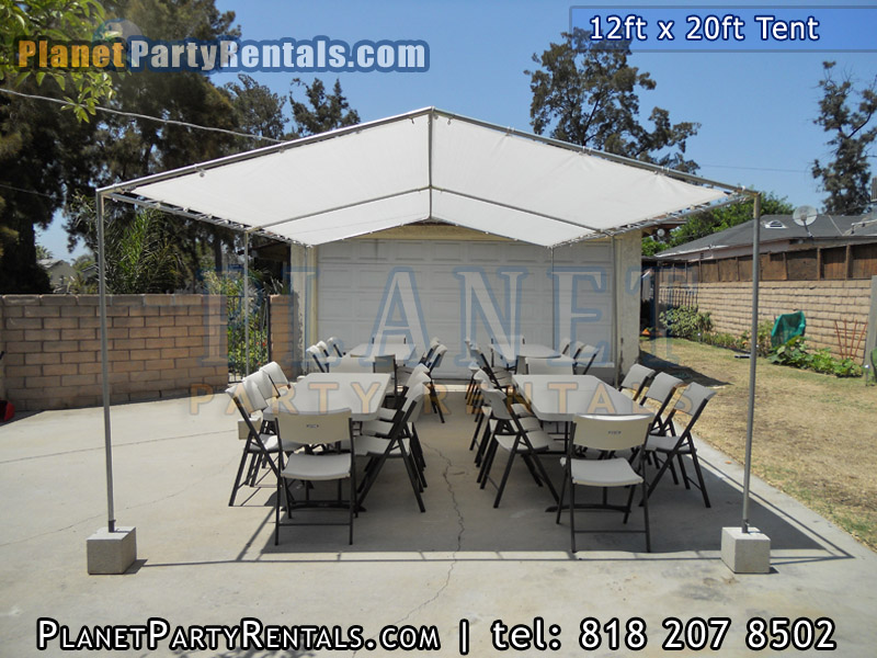 12ft x 20ft Tent with rectangular tables and chairs | The 12ft x20ft tent does not include walls, the tent provides shade for your guests, does not include sidewalls