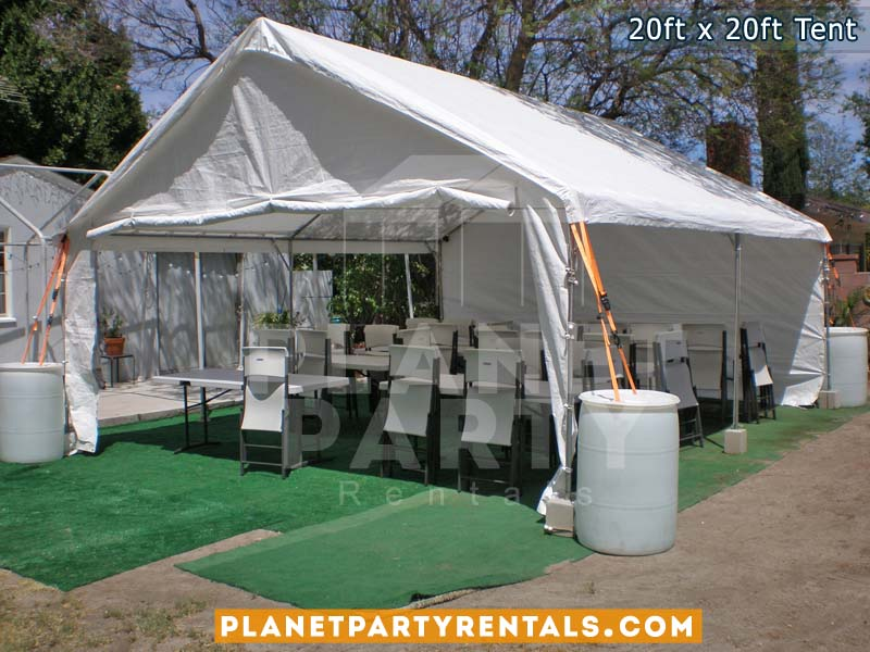 20ft x 20ft white party tent with sidewalls tables and chairs on artificial grass